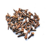Cloves. Dry cloves spread over white sheet Royalty Free Stock Photography