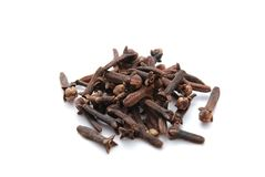 Cloves. Piled whole cloves on white background Royalty Free Stock Image