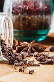 Cloves, allspice, star anise on a wooden board. Closeup royalty free stock photo