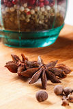 Cloves, allspice, star anise on a wooden board closeup. Cloves, allspice, star anise on a wooden board stock images