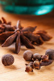 Cloves, allspice, star anise on a wooden board closeup. Cloves, allspice, star anise on a wooden board stock photos