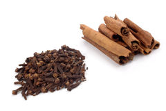 Cloves and Cinnamons Stock Images