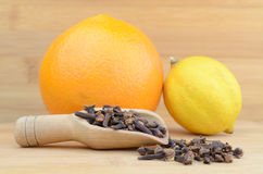 Cloves and fruits Stock Photos