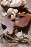 Cloves of garlic on a cutting board Royalty Free Stock Images