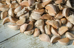 The cloves of garlic on old wooden surface. Close up Stock Photography