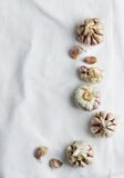 Cloves of garlic over white cloth Royalty Free Stock Photography