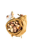 Cloves of garlic in a ramie sac Royalty Free Stock Photography
