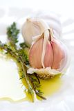 Cloves of garlic and sprig of fresh thyme Stock Photography