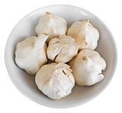 Cloves of garlic on white dish. Royalty Free Stock Photography