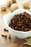 Cloves with nutmegs and bay leaves Stock Image