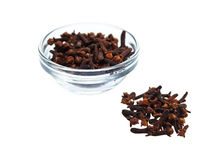 Cloves in and out the bowl Stock Photos