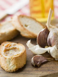 Cloves of Roasted Garlic spread Royalty Free Stock Photography