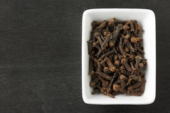 Cloves in sauceboat Stock Photo