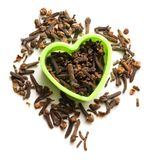 Cloves seeds in heart form Stock Photo