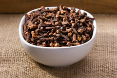 Cloves in small bowl Stock Images