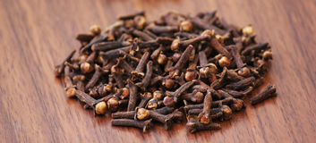 Cloves Spice on wooden beige background.-22 JULY 2017. Royalty Free Stock Photography
