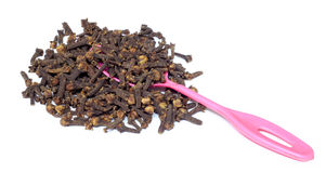 Cloves with a spoon Royalty Free Stock Images