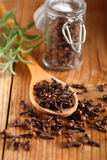 Cloves in the spoon Stock Photo