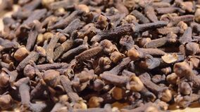 cloves on wooden board. spices and food ingredients. rotate macro shot