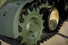 Clowe up view on new military light tank body, track, suspension road wheels with hard rubber tires to reduce noise. Russian army. Multipurpose military vehicle stock photos