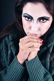 Clown. Sad girl with clown make-up Royalty Free Stock Image