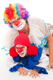 Clown. One child with an adult clown smiling Royalty Free Stock Images