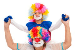 Clown. One child with an adult clown smiling Stock Image