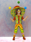 Clown. A cheerful clown in a cap and juggling balls Royalty Free Stock Photos