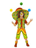 Clown. A cheerful clown in a cap and juggling balls Royalty Free Stock Image