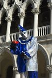 Clown 2. A clown dressed in silver and purple,poses in Saint Marks Square,Venice,Italy,in preperation for Carnivale,the mardi gras of Europe Royalty Free Stock Images