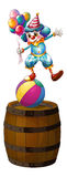 A clown above the barrel Stock Images