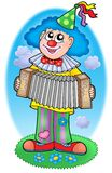 Clown with accordion on  meadow Royalty Free Stock Images