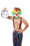 Clown with alarm clock Stock Images