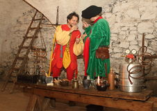 Clown and Alchemist. An alchemist and a clown toasting and smiling for some celebration, played as a summer 2015 performance at Svihov Water Castle, Western Stock Photo