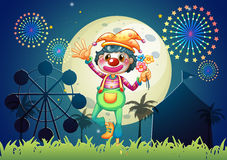 A clown at the amusement park. Illustration of a clown at the amusement park Stock Photos