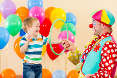 Clown amusing child boy on birthday party Stock Photo