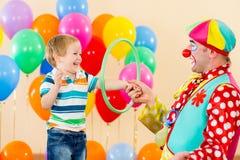 Clown amusing child boy on birthday party. Clown amusing kid boy on birthday party stock photo