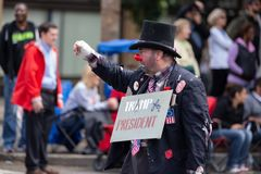 Clown with anti-Trump poster stock photos