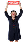 Clown with applause board Stock Photo