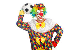 Clown avec la boule du football Photo stock
