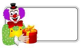 Clown avec le cadre de cadeau Photos stock