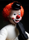Clown avec le pied dans sa bouche Images libres de droits