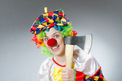Clown with axe in funny concept Stock Photo