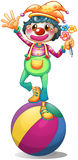 A clown balancing above a ball Royalty Free Stock Images
