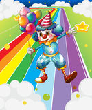 A clown with balloons at the colorful street Royalty Free Stock Images