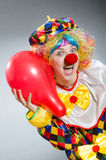 Clown with balloons in funny concept Royalty Free Stock Photo