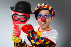 Clown with balloons in funny concept Stock Photos