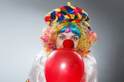 Clown with balloons in funny concept Stock Image