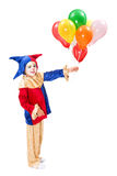 Clown with balloons. Little girl clown holding many colorful balloons Royalty Free Stock Photo