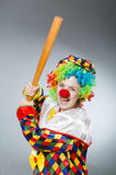 Clown with baseball bat in funny concept Stock Photos